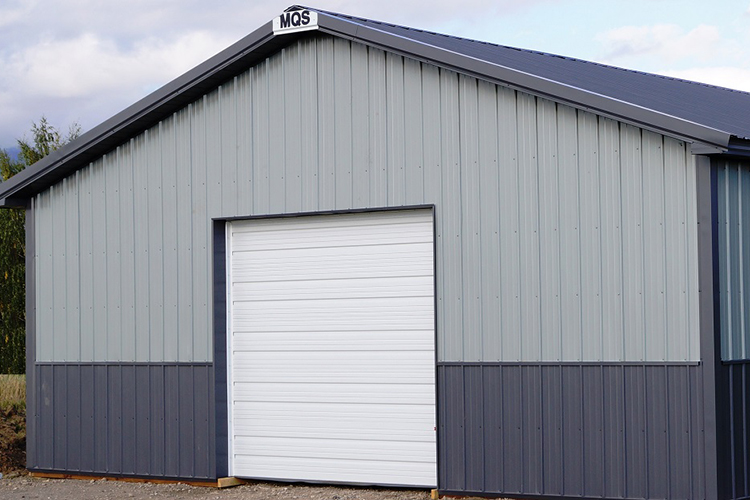 gray pole barn with white garage